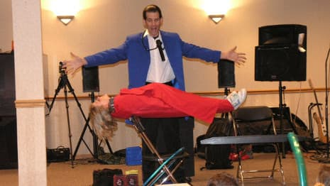 The magician levitates a child in mid-air!